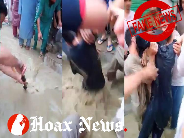 Boy rescued from manhole.jpg